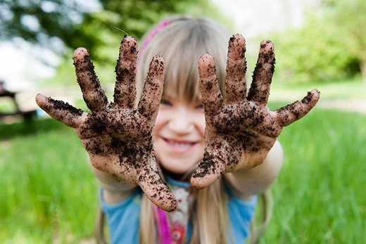 Girl with soil on her hands