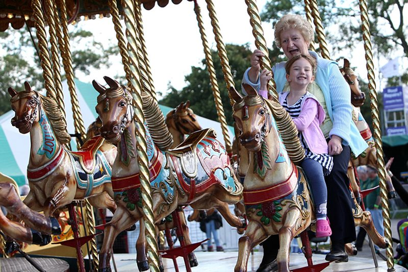 Girl and grandma on carousel