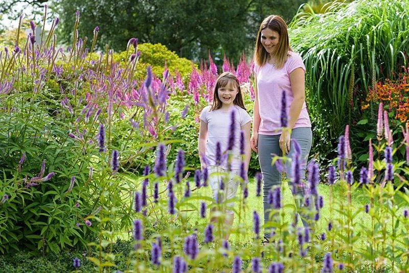 Mother and daughter enjoy the planted borders