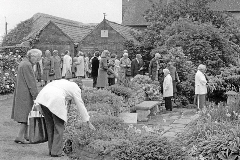 A collection of photos showing an open day in the 1970s. Notice the Sunday Best clothing.