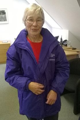 Volunteer Joan modelling the new uniform