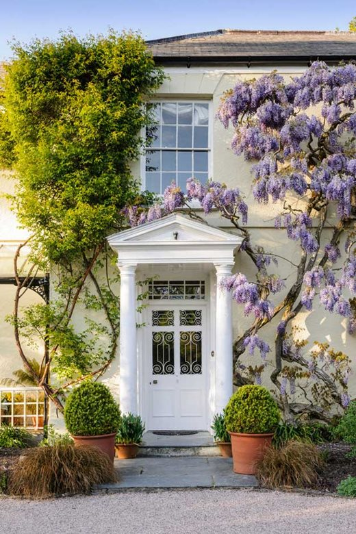Stay in the wisteria-covered Rosemoor House