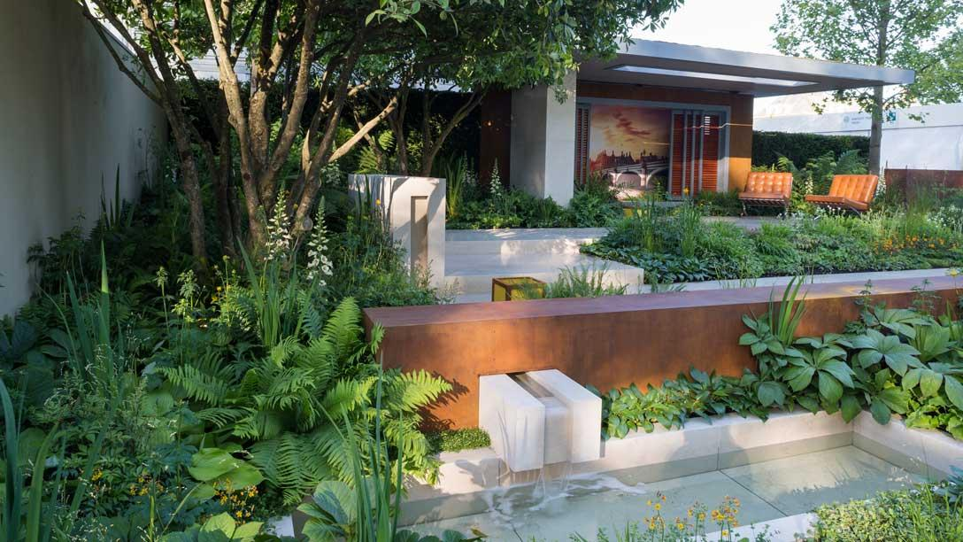 Large multi-stemmed trees offer a dappled shade over the muted colour planting