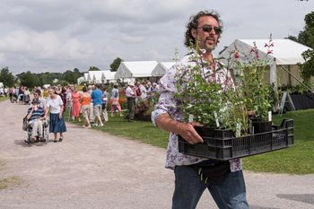 A show visitor carries some flowers