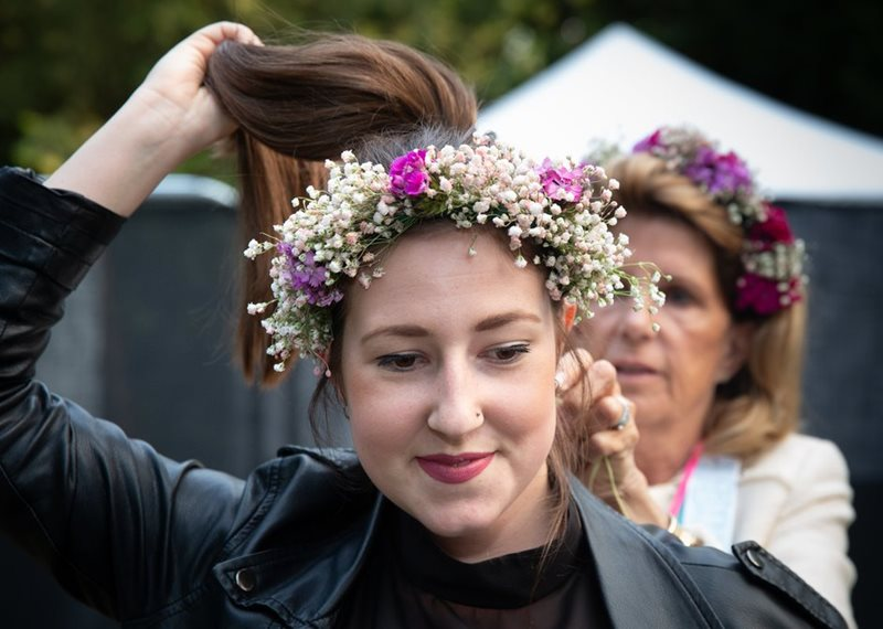 Girl having flower crown fitted