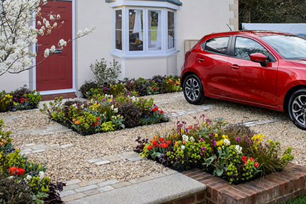 Although There Is Room To Park, Plants Feature Heavily In This Garden.  There Is