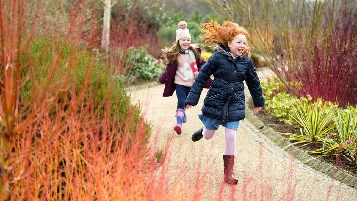 Girls running through the Winter Garden