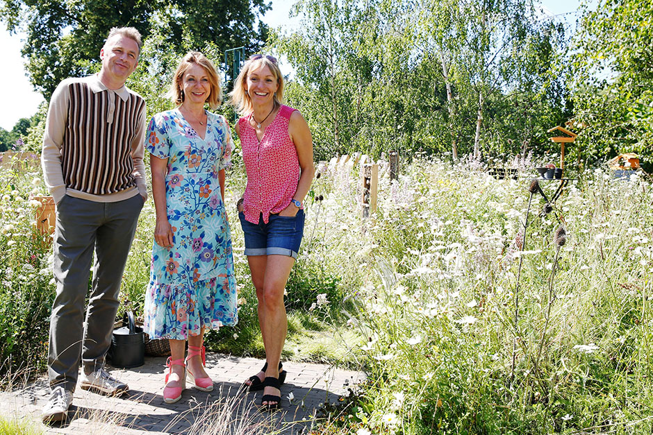 Presenters Chris Packham (L) and Micheala Strachan (R) pose with garden designer Jo Thompson on the BBC Springwatch Garden