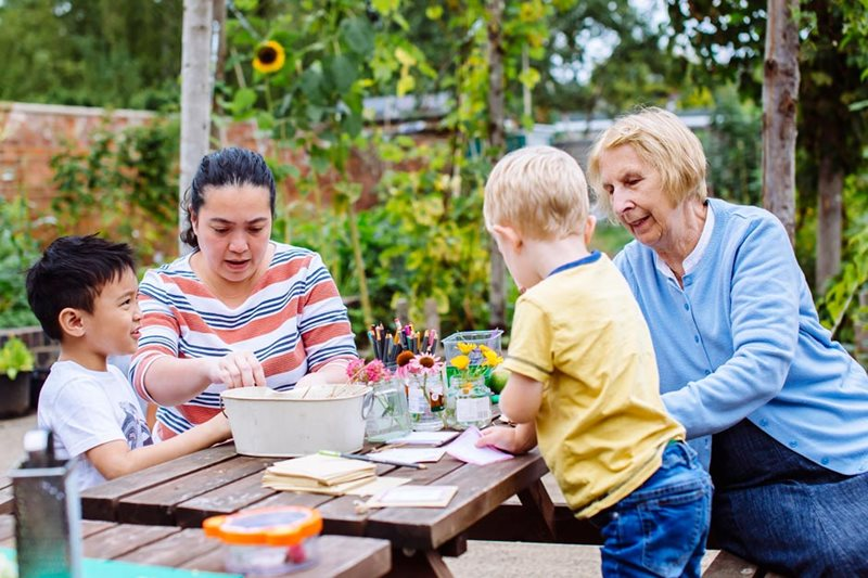 Family gardening session at Erleigh Road Community Garden