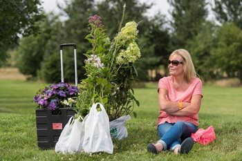A visitor takes a rest at the Hyde Hall Flower Show
