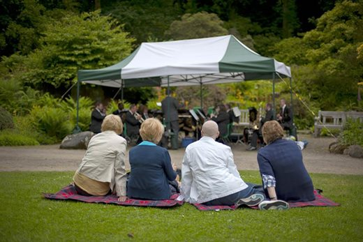 Visitors listening to music at Harlow Carr
